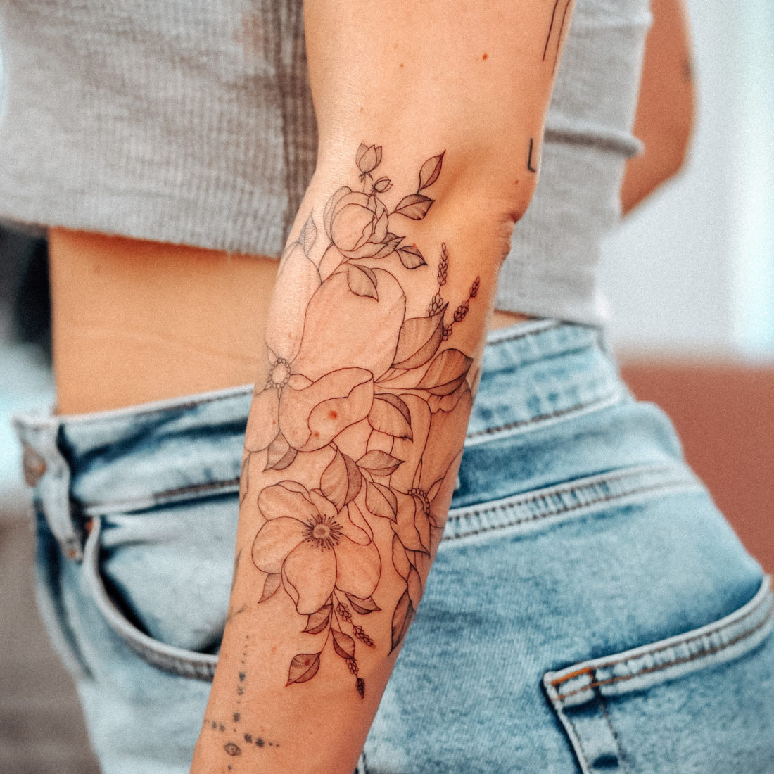 Wild flower sleeve fineline tattoo
