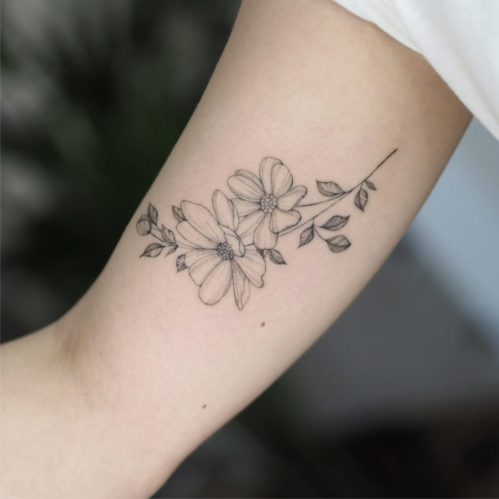 Fineline wildflower tiny floral branch singleneedle tattoo