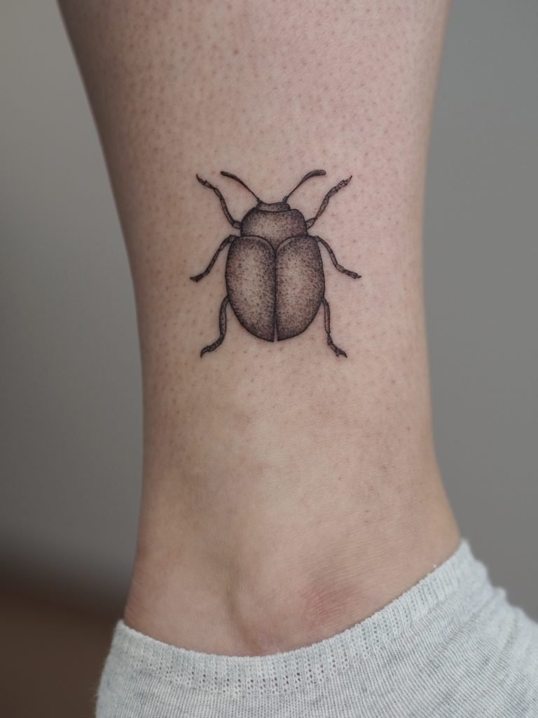 Beetle microrealistic tattoo