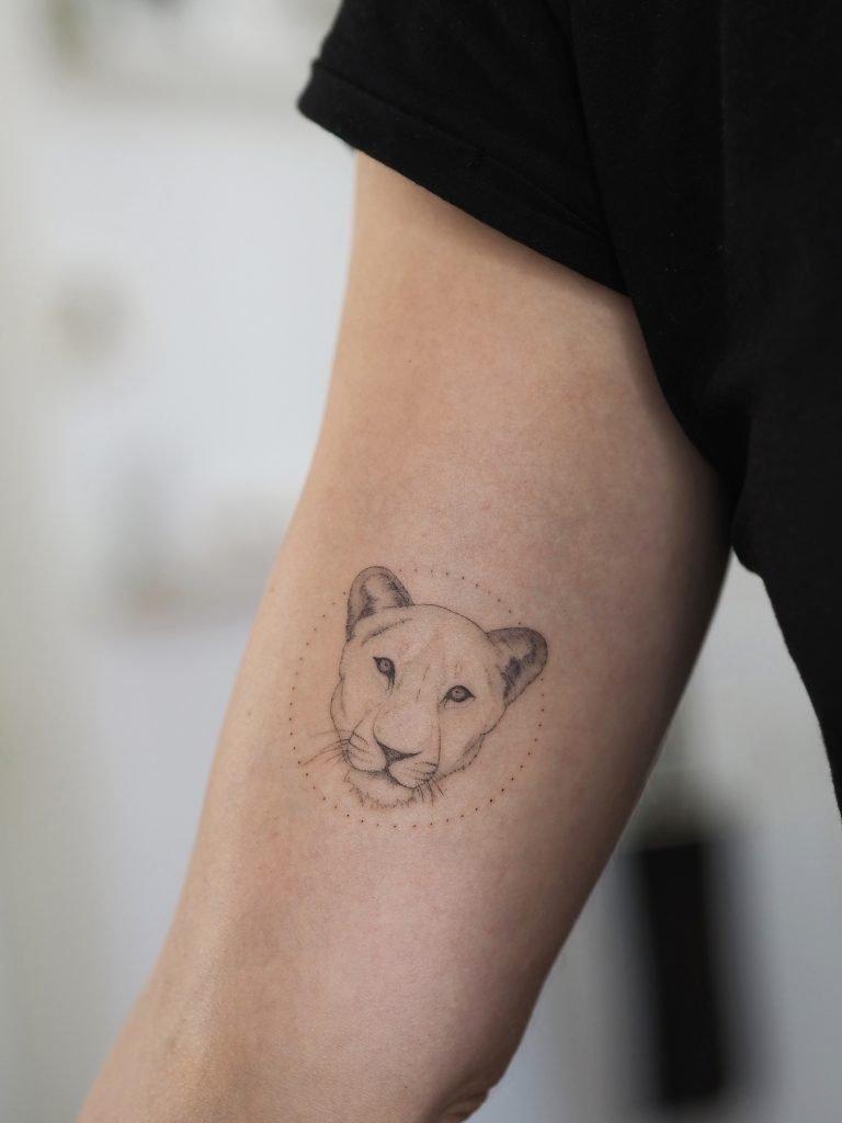 Lioness microrealistic portrait singleneedle tattoo
